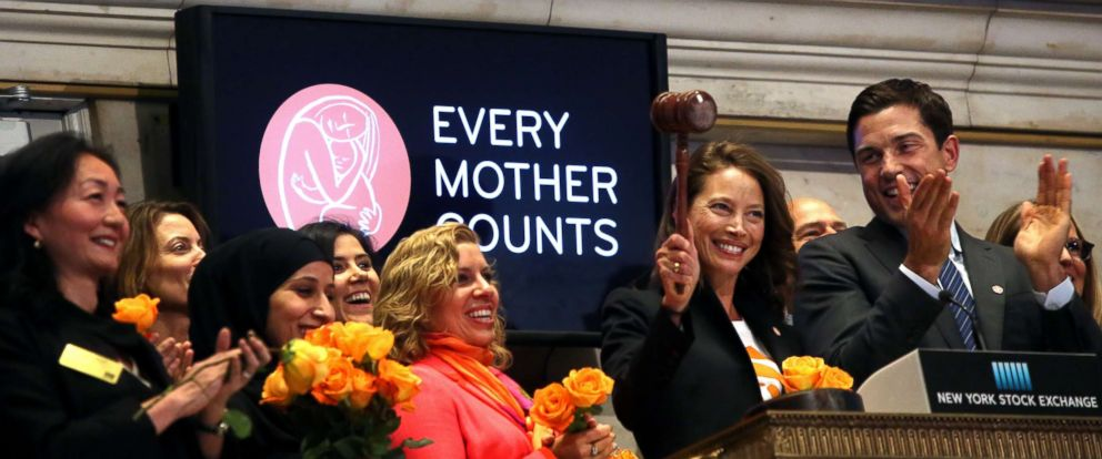 PHOTO: Christy Turlington,center, and employees of the non-profit organization Every Mother Counts, ring the closing bell of the New York Stock Exchange on April 29, 2016 in New York City.