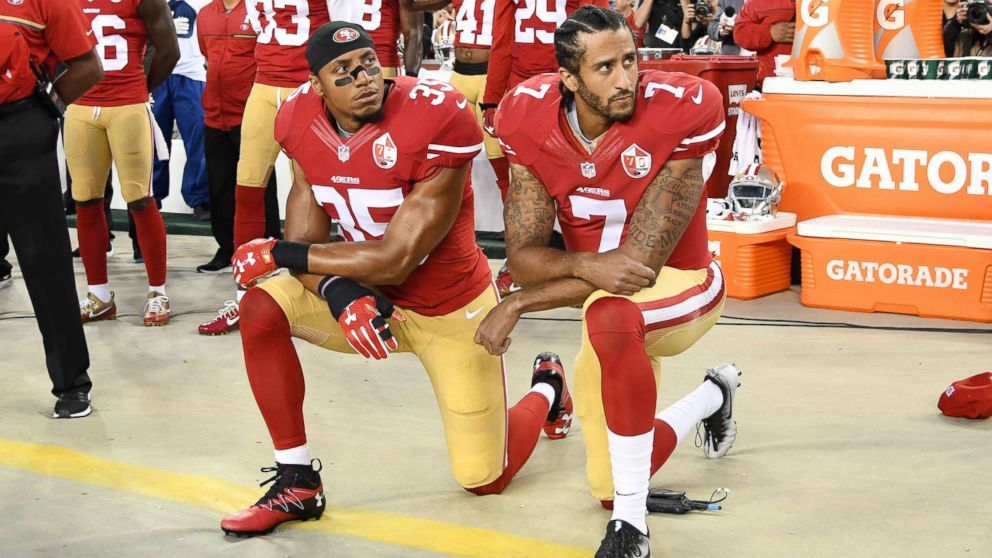 Colin Kaepernick and Eric Reid of the San Francisco 49ers kneel in protest during the national anthem prior to playing the Los Angeles Rams in their NFL game at Levi's Stadium on Sept. 12, 2016 in Santa Clara, Calif.
