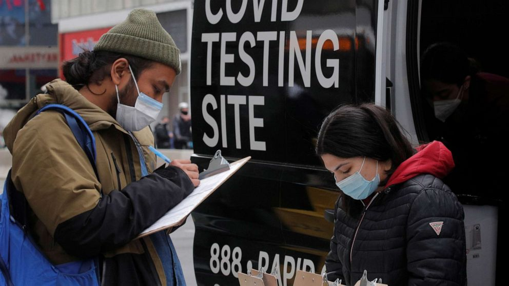 PHOTO: A man signs up to take a COVID-19 test at a mobile testing van in Herald Square in New York, March 16, 2021.