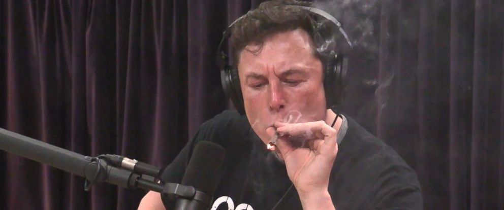 PHOTO: Tesla founder Elon Musk smokes what Joe Rogan described as a mix of tobacco and marijuana in an image made from video posted to YouTube on Sept. 6, 2018.