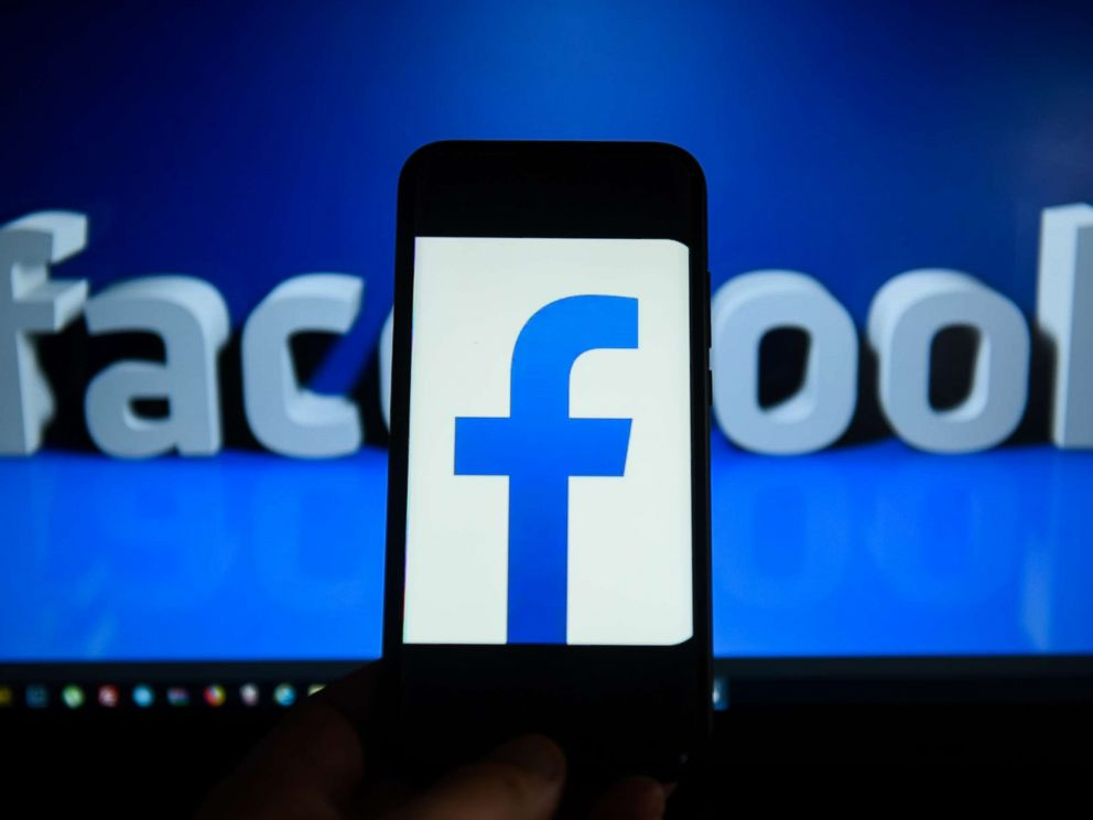PHOTO: Facebook logo is seen on an android mobile phone in front of a computer screen.