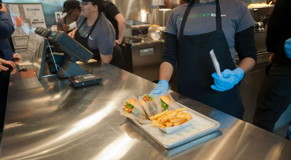 PHOTO: In this Dec. 20, 2011, file photo, orders are picked up at the Shake Shack in Downtown Brooklyn in New York.