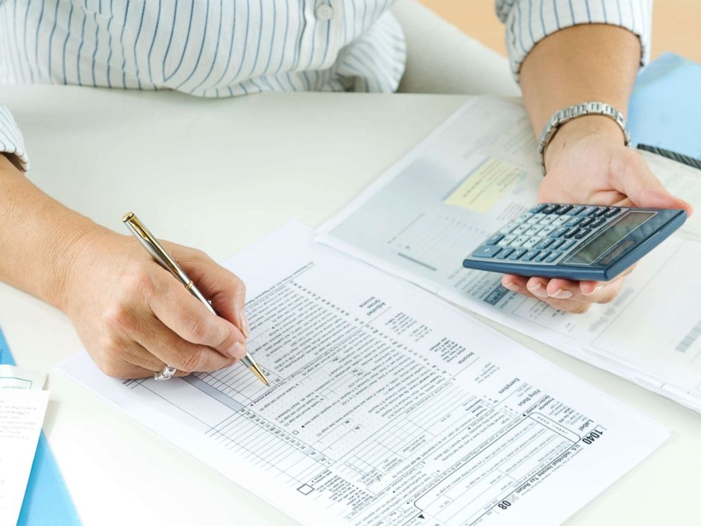PHOTO: A woman calculates her taxes in this undated stock photo.