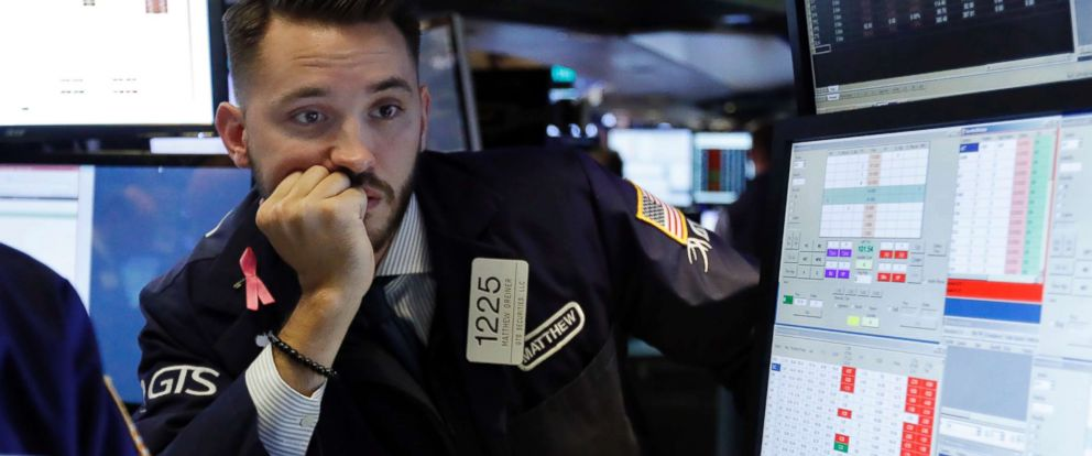 PHOTO: Specialist Matthew Grenier works on the floor of the New York Stock Exchange, Oct. 23, 2018.