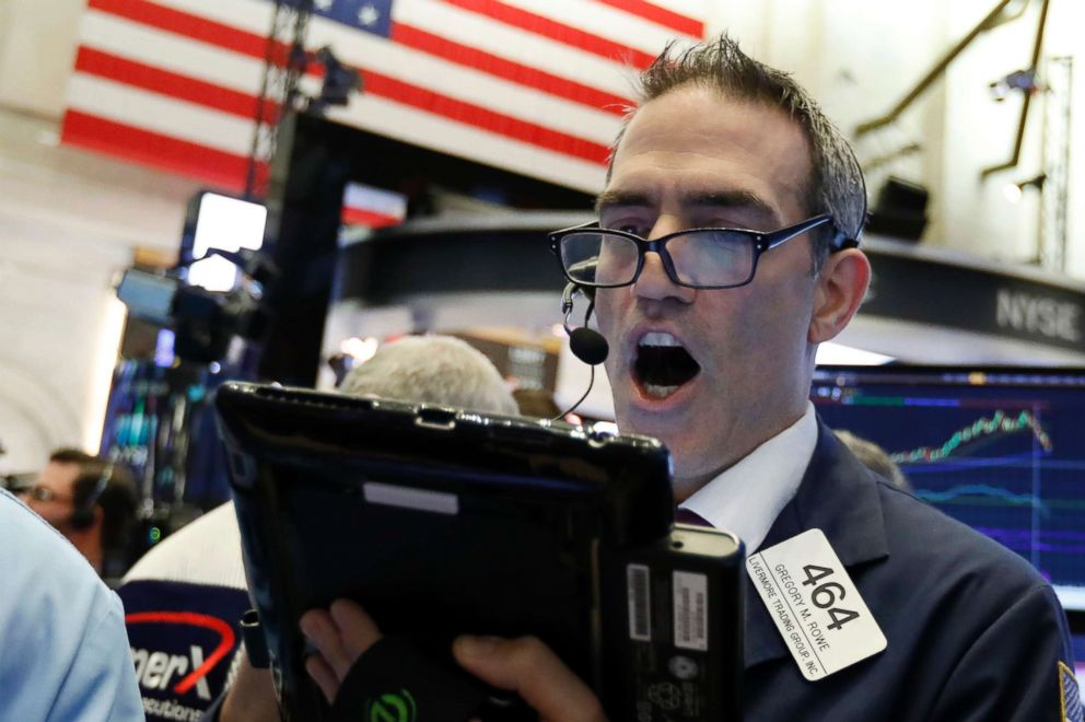 PHOTO: Trader Gregory Rowe works on the floor of the New York Stock Exchange, Oct. 23, 2018.