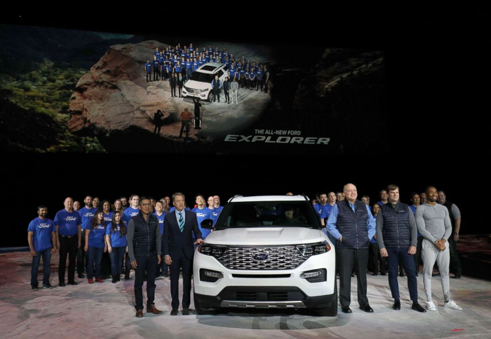 Ford executives and the Ford Explorer team pose with the all-new 2020 Ford Explorer SUV at its reveal, Jan. 9, 2019, in Detroit.