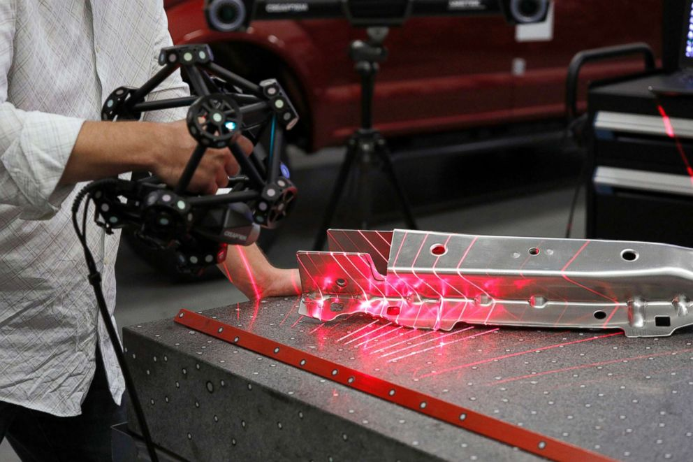 PHOTO: A Ford Motor Company worker operates a Creaform laser scanning measuring device at the Ford Dearborn Truck Plant, Sept. 27, 2018, in Dearborn, Michigan.