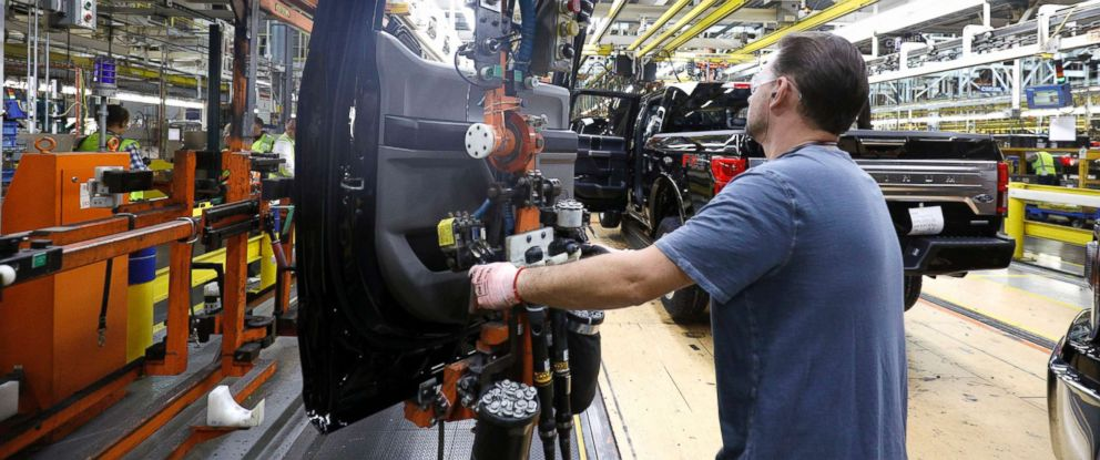 PHOTO: A Ford Motor Company workers works on a Ford F150 truck on the assembly line at the Ford Dearborn Truck Plant, Sept. 27, 2018, in Dearborn, Michigan.
