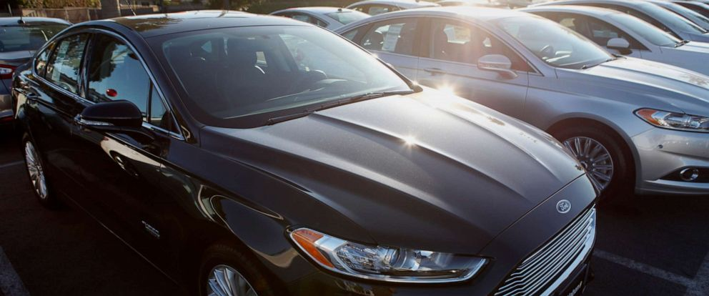 PHOTO: Ford Fusion vehicles are displayed for sale at a dealership in Torrance, Calif., July 30, 2013.