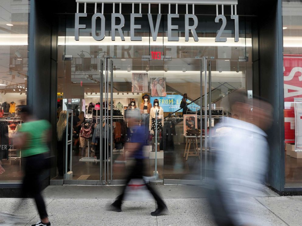 PHOTO: People walk by the clothing retailer Forever 21 in New York City, Sept. 12, 2019.