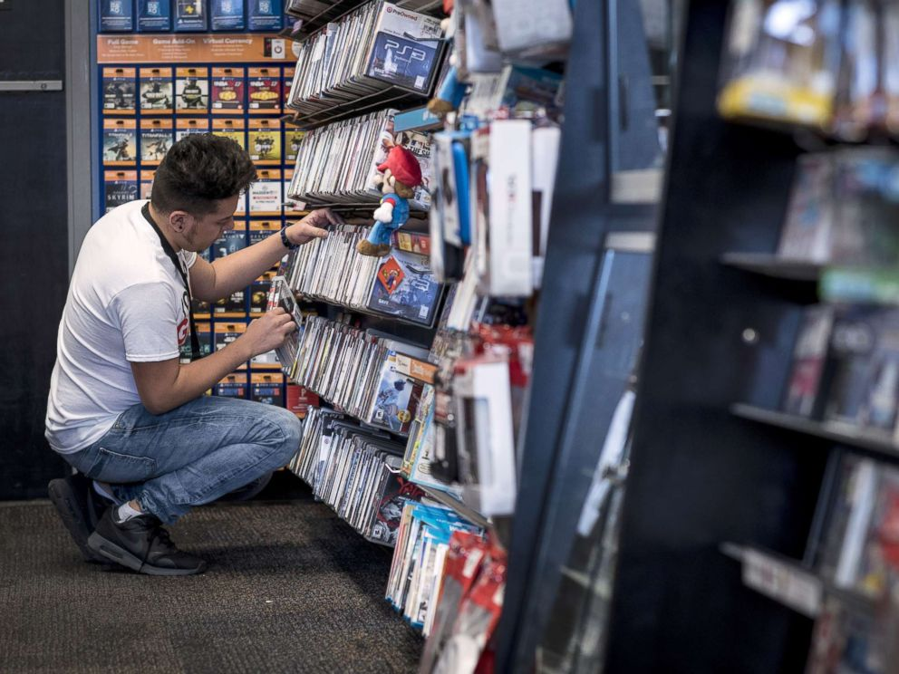 PHOTO: A worker organizes video games at a GameStop Corp. store in Chicago, Nov. 20, 2016.