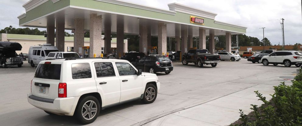 PHOTO: Cars jockey for position at the CEFCO gas station at County Road 393 and U.S. Highway 98 in South Walton County in Santa Rosa Beach, Fla., Oct., 9, 2018.