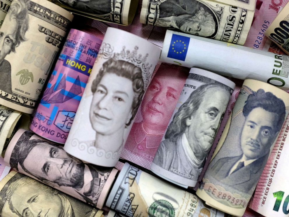 PHOTO: Euro, Hong Kong dollar, U.S. dollar, Japanese yen, pound and Chinese 100 yuan banknotes are seen in this picture illustration.