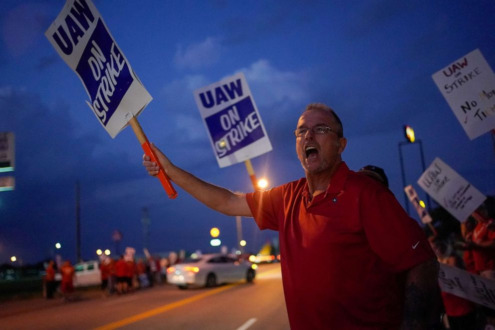PHOTO: Charlie Highlanger, 59, a GM employee shouts at passing employees entering the assembly plant outside the General Motors Bowling Green plant during the United Auto Workers (UAW) national strike in Bowling Green, Kentucky, Sept. 20, 2019.
