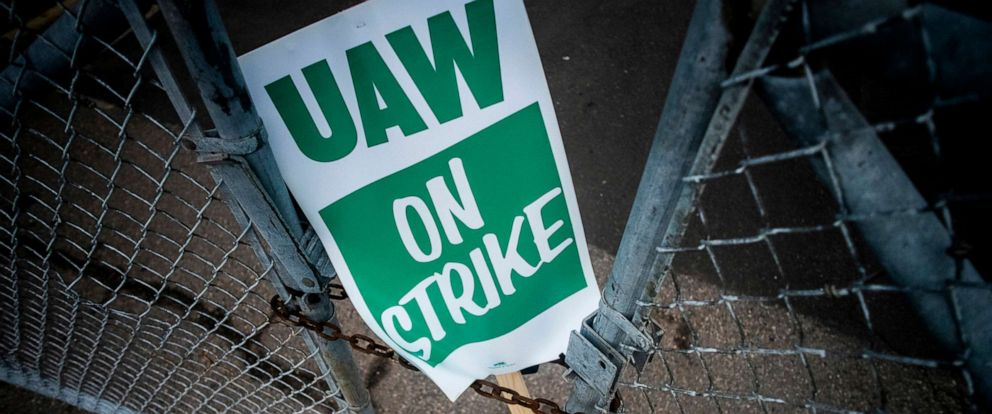 PHOTO: A United Auto Workers strike sign rests between the chains of a locked gate entrance outside of Flint Engine Operations in Flint, Mich., Sept. 16, 2019.
