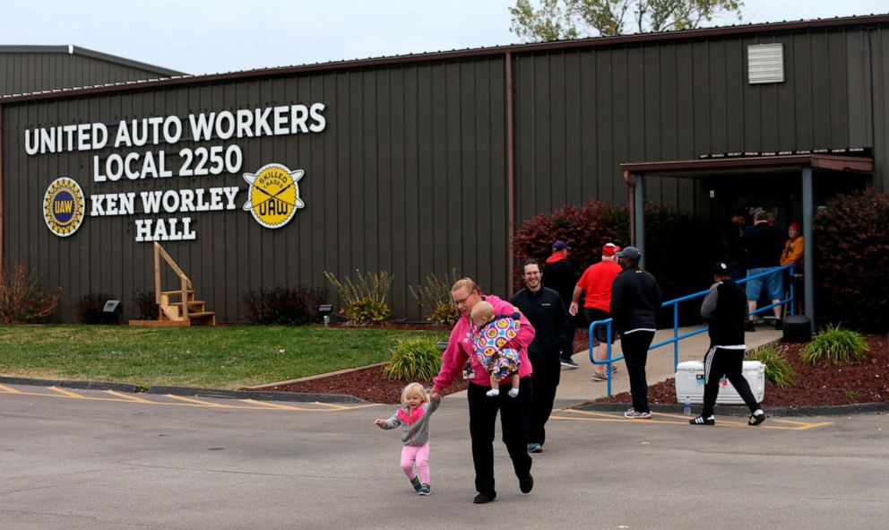 PHOTO: United Auto Worker Lindsey Higgins, exits the the UAW Local 2250 Ken Worley Hall with her two children after voting on the offer made to union workers by General Motors on Oct. 24, 2019, in Wentzville, Mo.
