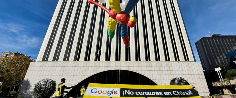 """PHOTO: Amnesty International activists hold a giant dragonfly-shaped balloon with a banner reading """"Google, do not censor in China, no to the Dragonfly project"""" during a protest outside the Google headquarters in Madrid, Nov. 27, 2018."""