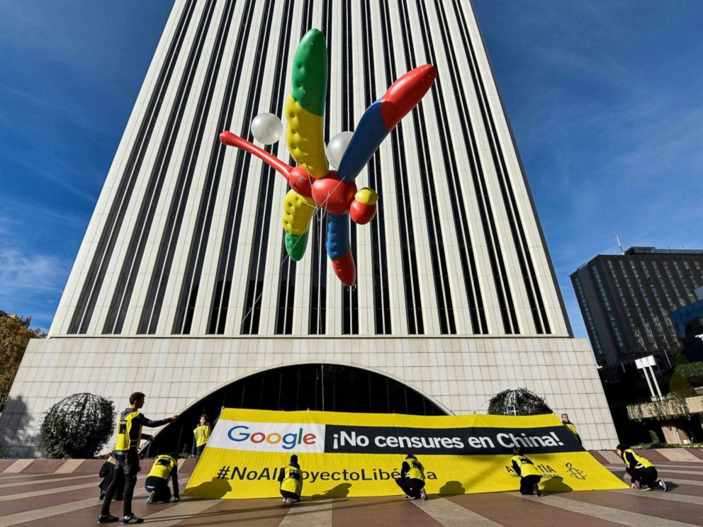 PHOTO: Amnesty International activists hold a giant dragonfly-shaped balloon with a banner reading Google, do not censor in China, no to the Dragonfly project during a protest outside the Google headquarters in Madrid, Nov. 27, 2018.