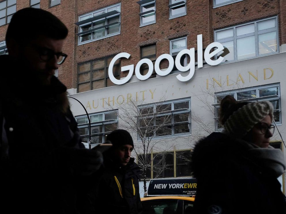 PHOTO: People walk past a Google office building on 9th Avenue in Chelsea district in New York, Dec. 30, 2017.
