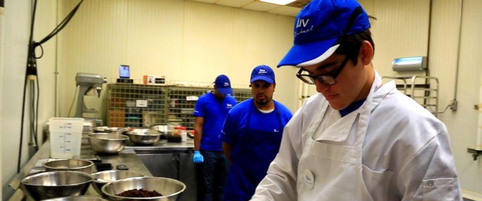 PHOTO: Sam Antar, 22, makes granola at the Luv Michael nonprofit in Long Island City, New York.