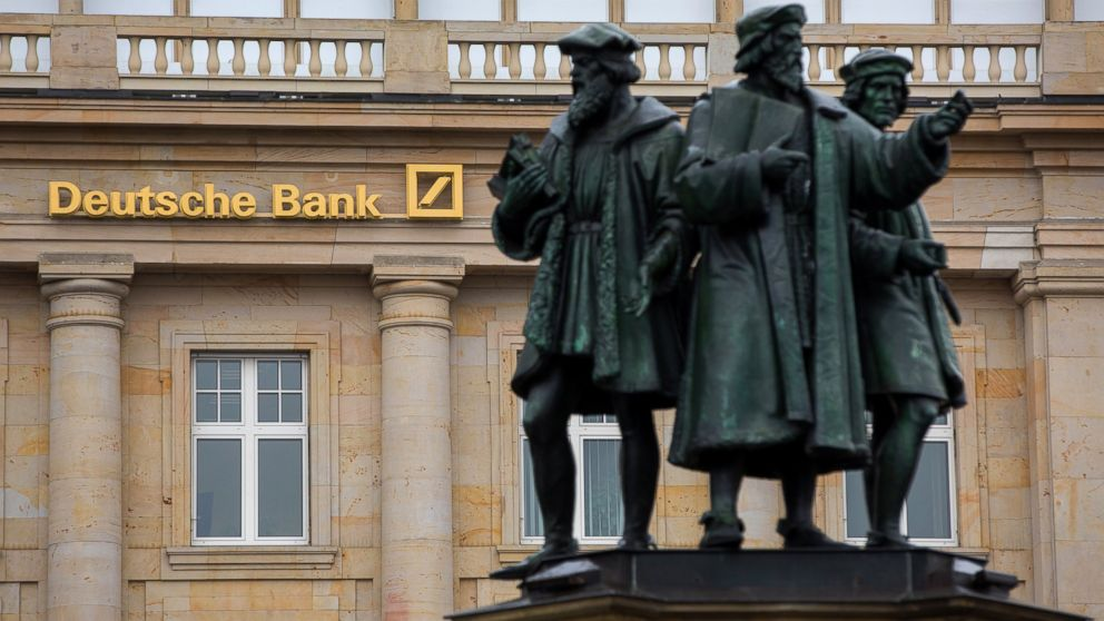 Statues stand outside a Deutsche Bank AG bank branch in Frankfurt, Germany, on Oct. 20, 2016.