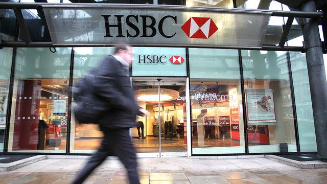 PHOTO: A pedestrian passes an HSBC Holdings Plc bank branch in London, U.K., Feb. 23, 2011.