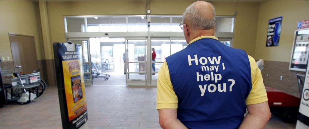 PHOTO: A Wal-Mart greeter waits to welcome new customers to the new 2,000 square foot Wal-Mart Supercenter store May 17, 2006 in Bowling Green, Ohio