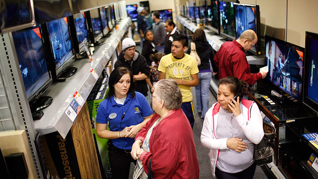PHOTO: Customers shop for plasma and flat screen televisions at Best Buy electronics store, In this Nov. 27, 2009 file photo in Fort Worth, Texas.