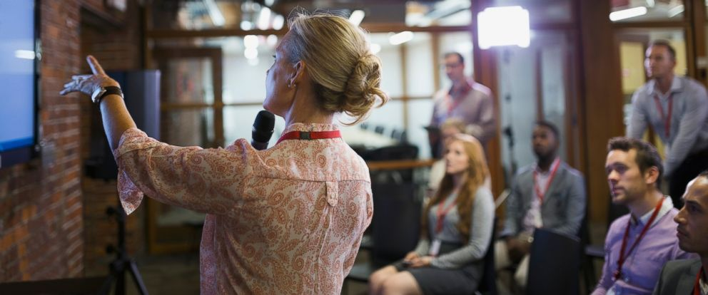 PHOTO: A businesswoman speaks in front of a small crowd in an undated stock photo.