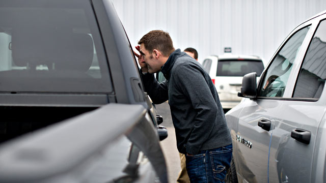 PHOTO: Joe DeLucia looks over a pickup truck as he shops for a vehicle in Peoria, Illinois.