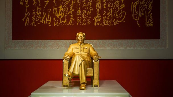 PHOTO: A gold and jade statue of former Chinese leader Chairman Mao Zedong is unveiled during the Art Shenzhen 2013 exhibition at Shenzhen Convention and Exhibition Center on December 13, 2013 in Shenzhen, China.