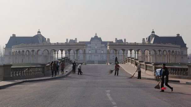 PHOTO: Workers clean the road at the Beijing Laffitte Chateau hotel, a multi-million dollar replica of Frances historic Chateau Maison-Laffitte, on June 12, 2011 in Beijing, China. It houses a luxury hotel, spa and wine museum.