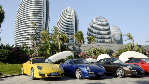 PHOTO: This picture taken on January 19, 2013 shows several sports cars parked in front of luxury apartment blocks at the seaside city of Sanya, in Chinas southern Hainan province.