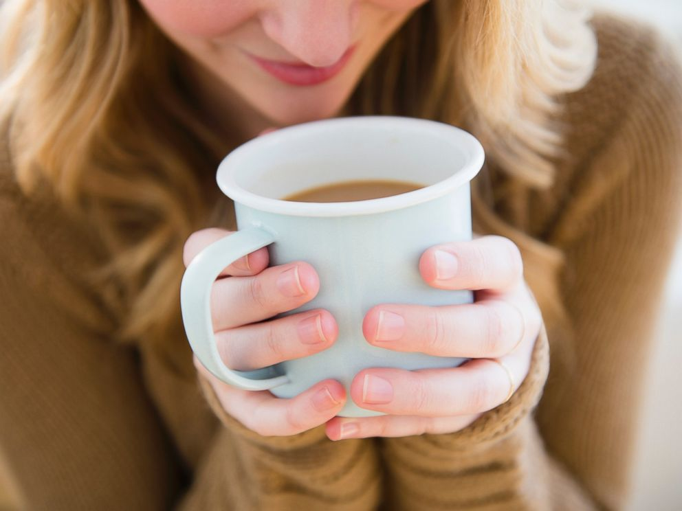 PHOTO:A woman is seen holding a coffee mug in this undated file photo.