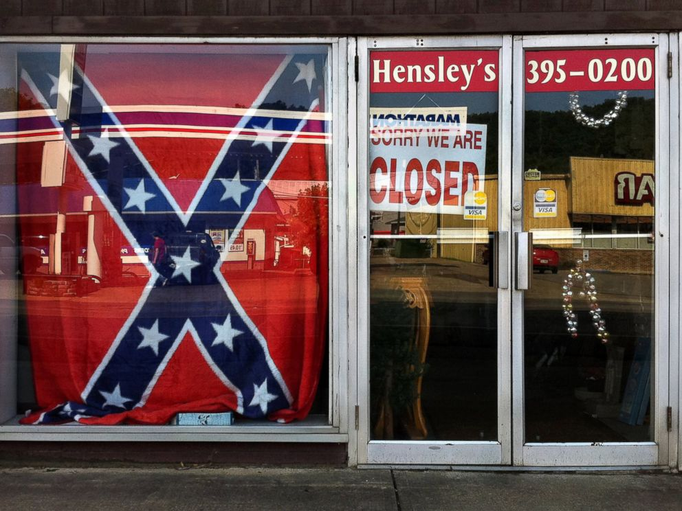 PHOTO: A Confederate flag covers a window of a store in a small town in Georgia on June 21, 2015.