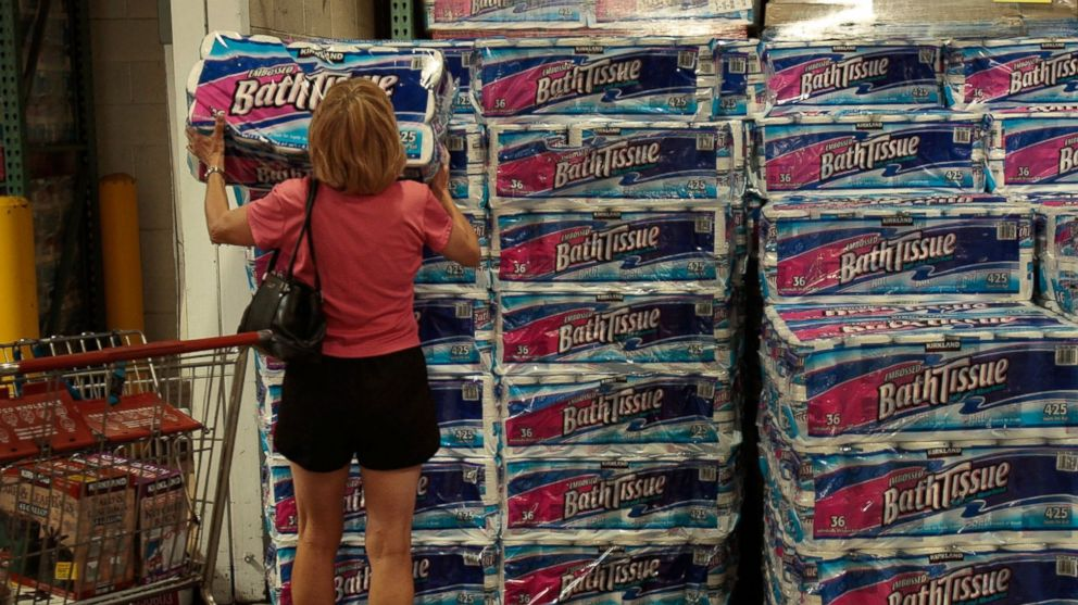 A shopper grabs a bulk package of toilet paper at a Costco store April 4, 2008 in Tucson, Ariz.