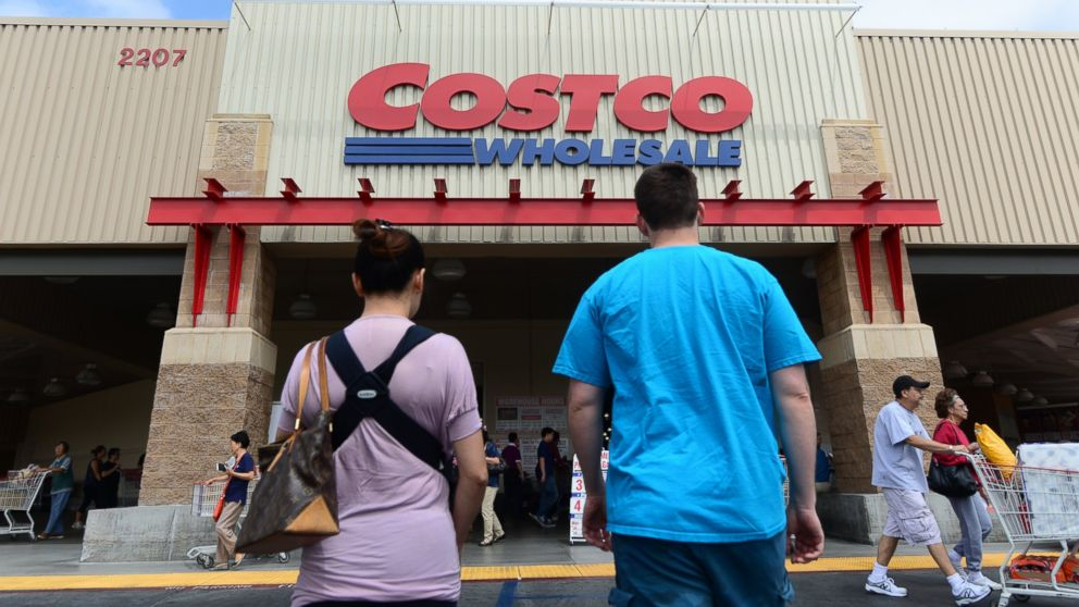A couple make their way toward the entrance of a Costco store in Alhambra, Calif. on June 2, 2013.