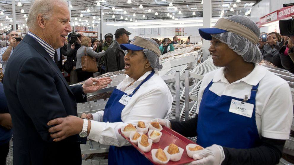 Vice President Joe Biden tries food samples during a visit to a Costco store on a shopping trip in Washington, DC, on Nov. 29, 2012.
