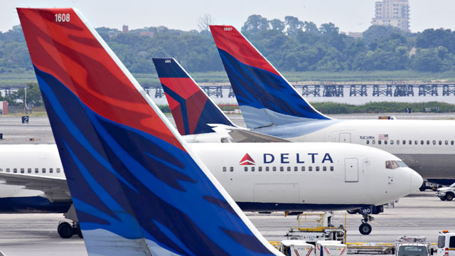 PHOTO: A Delta Air Lines plane taxis toward a gate between other Delta planes at John F. Kennedy International Airport in New York, U.S., on July 20, 2009.