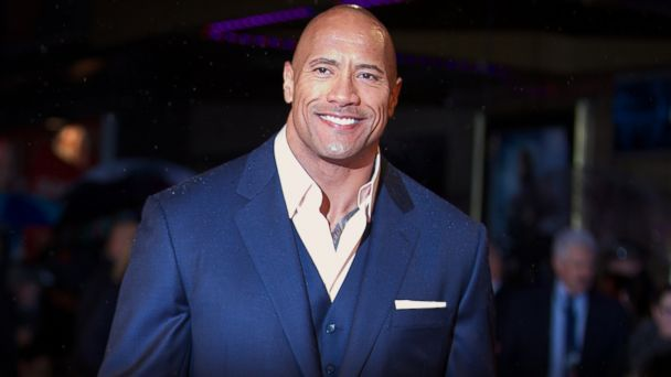 """PHOTO: Dwayne """"The Rock"""" Johnson poses for pictures on the red carpet as he arrives for the """"G.I. Joe: Retaliation"""" U.K. film premiere in central London on Mar. 18, 2013."""