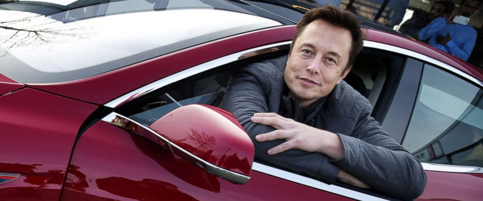 PHOTO: Elon Musk, co-founder and CEO of Tesla Motors, poses with a Tesla during a visit to Amsterdam on January 31, 2014.