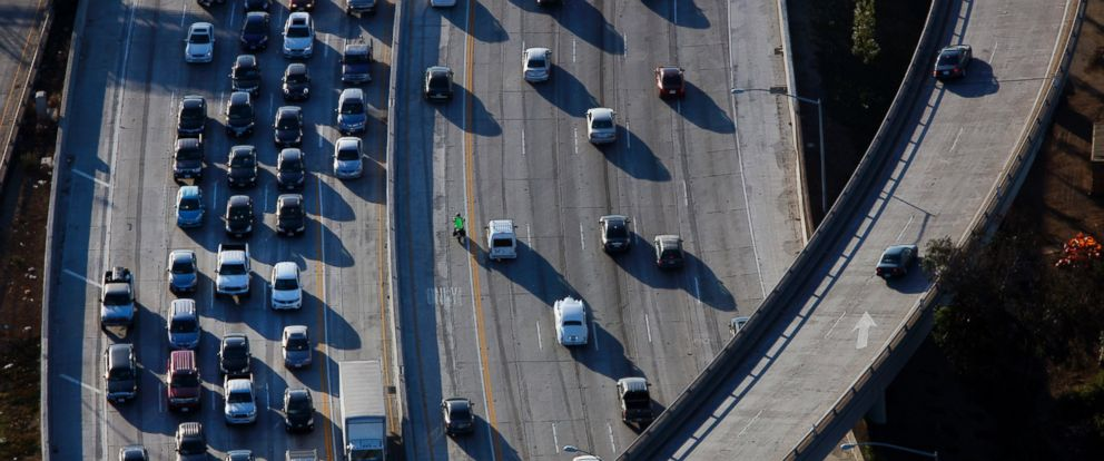 PHOTO: Vehicles sit in rush hour traffic at the interchange between the Interstate 405 and 10 freeways in Los Angeles, Calif., July 10, 2015.