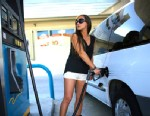 PHOTO: Carolina Villar pumps gas on Feb. 4, 2013 in Miami.