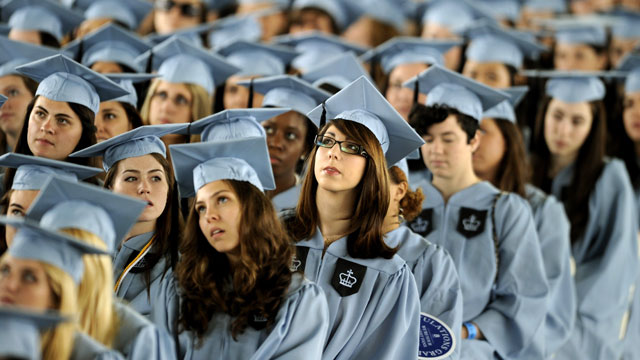 PHOTO: Graduates listen to US President Barack Obama as he delivers the Commencement Address at Barnard Colleges graduation ceremony in New York on May 14, 2012.