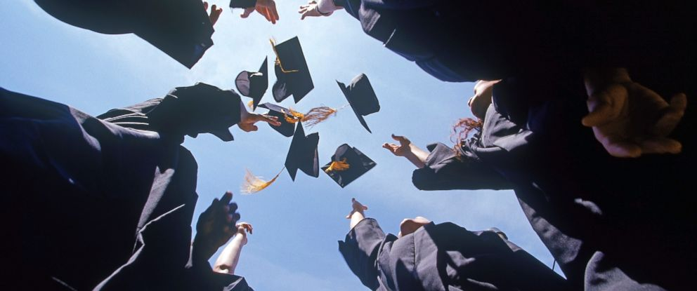 PHOTO: Graduates throw their caps in the air in an undated stock photo.