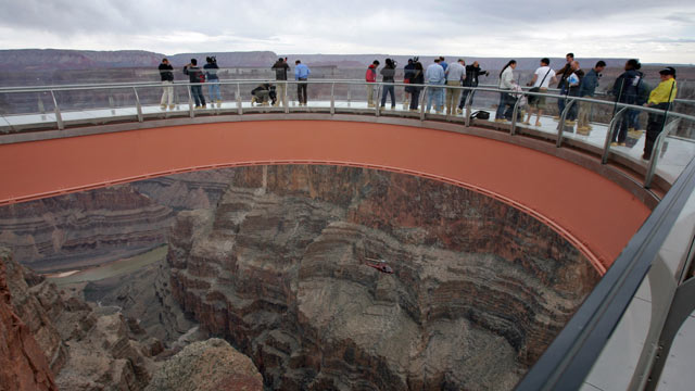 PHOTO: Visitors walk on the Skywalk at Grand Canyon West following the opening ceremony on the Hualapai Indian Reservation in Arizona, March 2007.