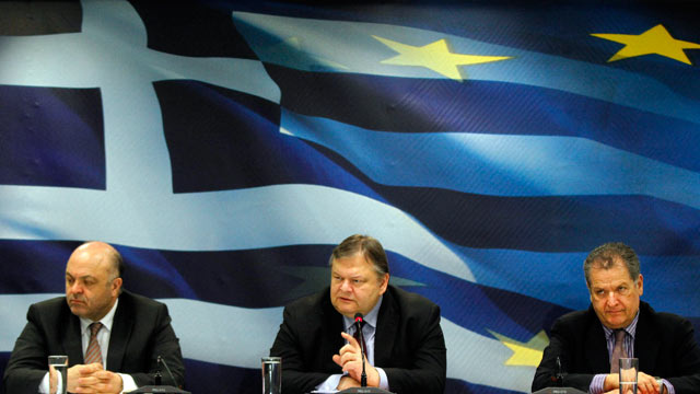 PHOTO: Evangelos Venizelos, Greeces finance minister, center, speaks while George Zanias, chairman of Greeces council of economic advisors, left, and Pantelis Economou, Greeces deputy finance minister, listen during a news conference, Athens, Greece, F