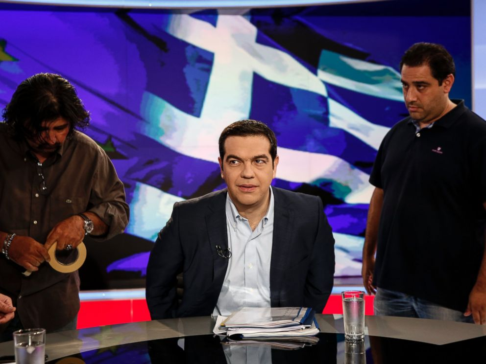 PHOTO: Alexis Tsipras, Greeces prime minister, center, takes his seat for a televised interview in Athens, Greece, June 29, 2015.