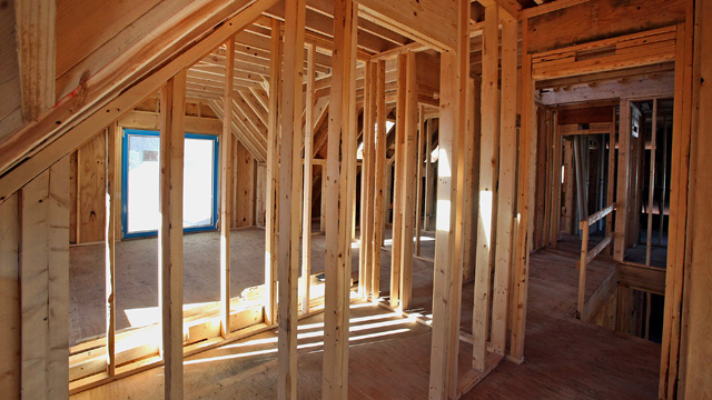 PHOTO: Framing studs stand inside of a new home under construction in Park Ridge, Illinois, U.S., on Nov. 28, 2012.