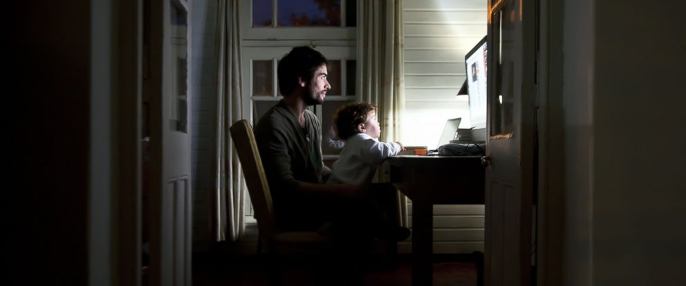 PHOTO: An undated stock image shows a man and a child using a home computer.